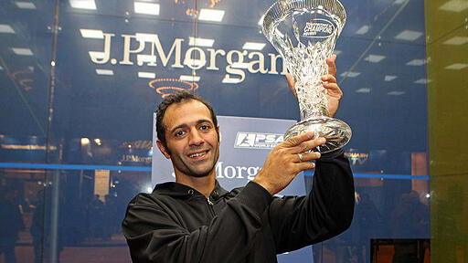 Amr Shabana hoisting the trophy after winning the 2014 Tournament of Champions